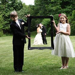 Ok....I'm convinced.  I have to find a large picture frame at Goodwill somewhere.  This is absolutely adorable.  I would love to do this for Kelli's wedding.
