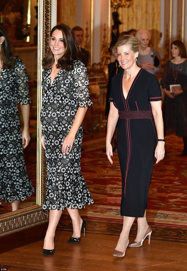 Glamorous duo: Kate, elegant in a guipere lace that showed off her bump to perfection, was joined by Sophie, Countess of Wessex as they hosted stars from the fashion world at Buckingham Palace tonight