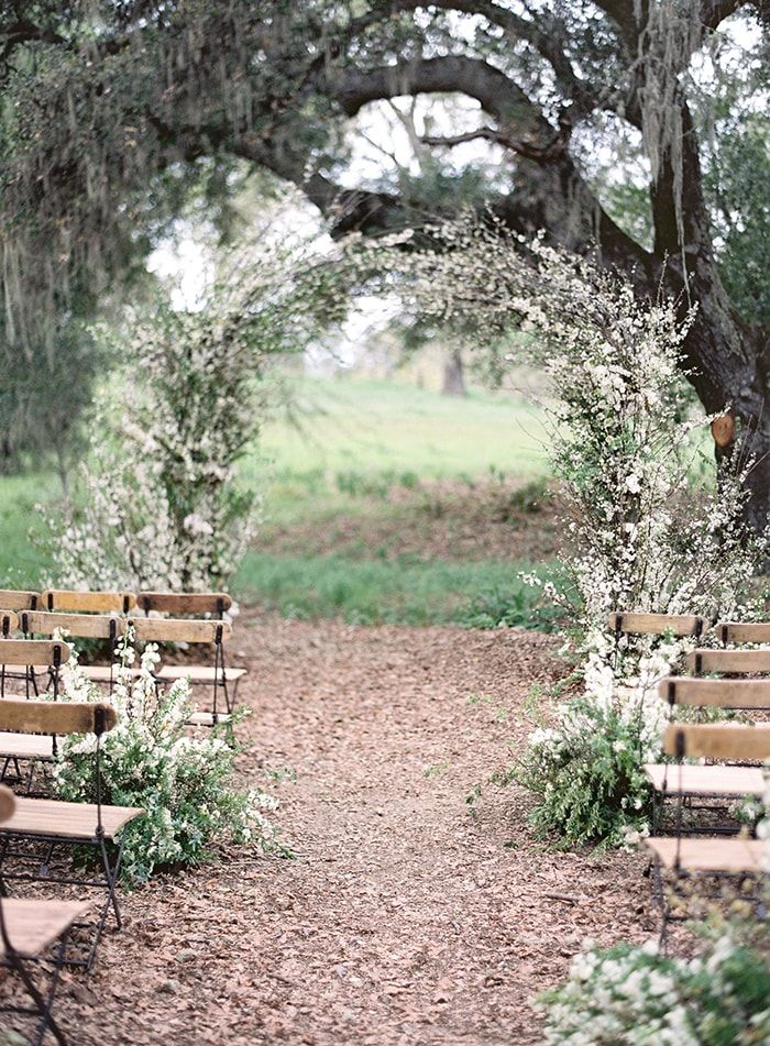 Delicate Spring wedding ceremony flower arch by Sarah Winward.