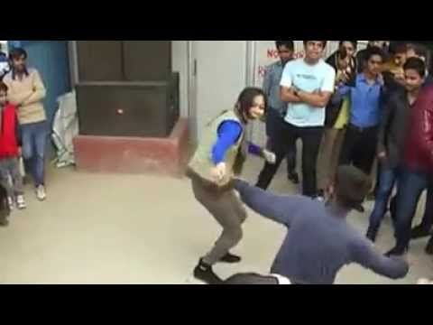 funny street dance in India by a beautiful lady with a funny street dance performer. she cannot control to get dance on street by watching public but after few minutes she realized this is not right place for dancing