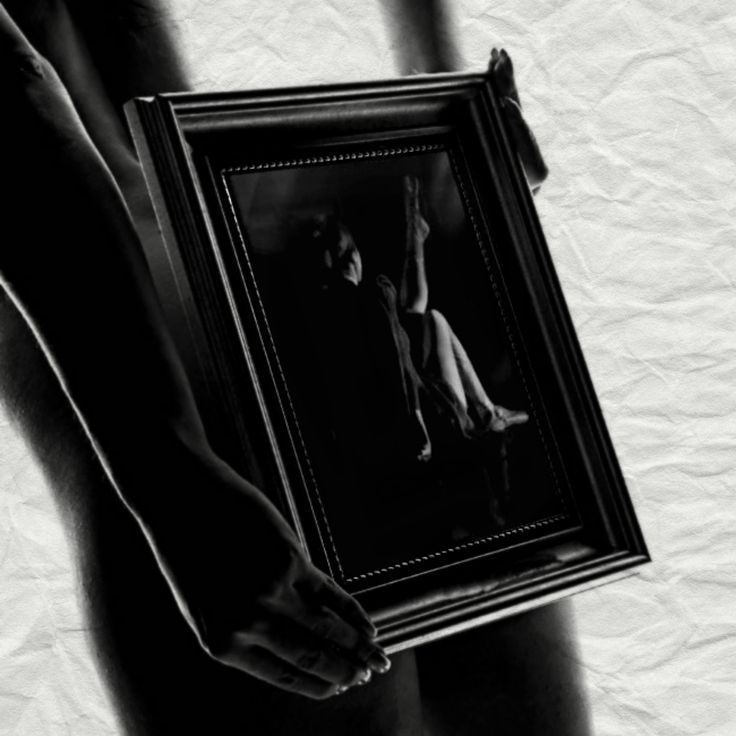 In the depths of the mirror the evening landscape moved by, the mirror and the reflected figures like motion pictures superimposed one on the other. The figures and the background were unrelated, a…