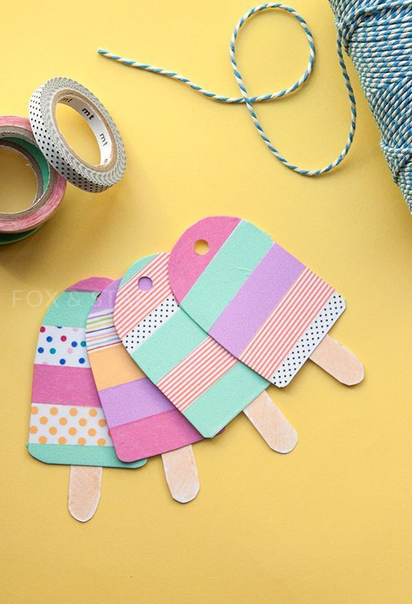 Whip up cute summer themed gift wrap with the help of some super easy washi tape ice lolly gift tags.