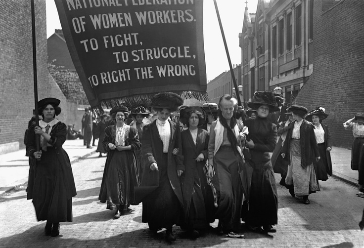 Mrs Despard, second from the right at the front row, leads a suffragette march by the National Federation of Women Workers in Bermondsey, London, in May 1911