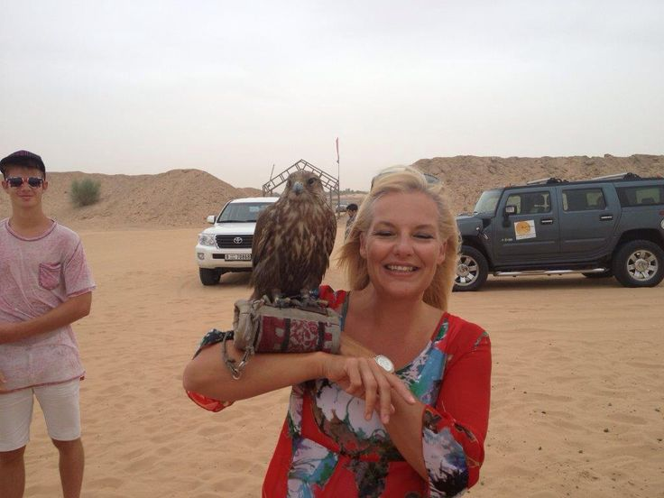 Holding a bird of prey in Dubai desert - Bedouin camp