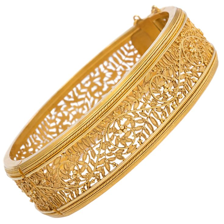 Antique French Gold Openwork Bracelet. An antique gold openwork bangle bracelet of foliate design with scrolled wirework in 18k. France. Interior circumference: