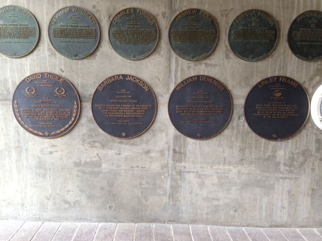 Cunneen Signs - Sydney Olympic Aquatic Centre; Cast plaques of all the great swimmers at the entrance of the building/pool