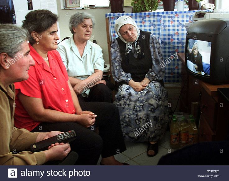 """Refugee women, Bosnian survivors of the 1995 Srebrenica massacre of thousands of Moslem men, watch live TV coverage of initial appearance of former Yugoslav president Slobodan Milosevic before the War Crimes Tribunal in the Hague, in refugee women organisations office in Sarajevo July 3, 2001. Milosevic refused to plead to the war crimes charges against him at the International Criminal Tribunal for former Yugoslavia and the judge said a """"not guility"""" plea would be entered on his behalf…"""