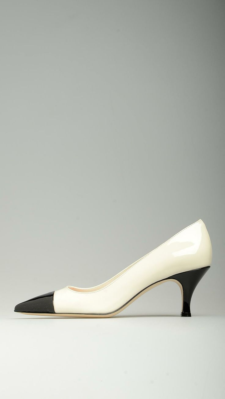 Pointed-toe patent leather court shoes in black and white, black toe, 2.5'' black heel, 100% leather.