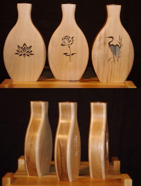 Stem or Bud Vases with scroll saw figures on face. Made from local poplar (faces) and butternut (center).  Each has a test tube inside to hold the stem/bud and some water.