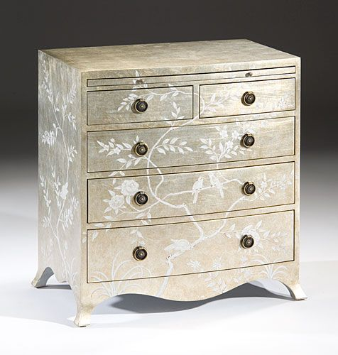 This lovely chest features a hand painted floral and bird design with a crackled silver finish. The chest features five drawers and a pull out writing shelf. The hardware features an antiqued brass fi