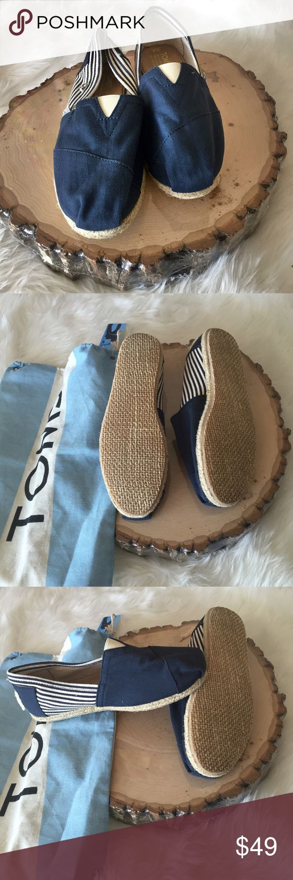Navy Blue TOMS NWOT Cream/Natural and navy stripes on sides and around the back. TOMS come in their bag which has a tag but no box. I did wear the shoes around the house to see if they fit me which they did not. TOMS Shoes
