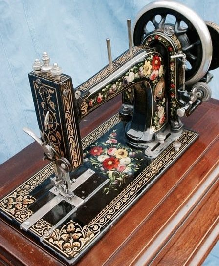 Vintage sewing machine. This is the most ornate beauty I've ever seen! (gaw) A Bradbury High Arm Family Combination c. 1902