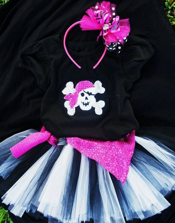 Over the top Halloween Costume. Prissy and sassy pirate costume set includes top, tutu, scarf belt, & bow.