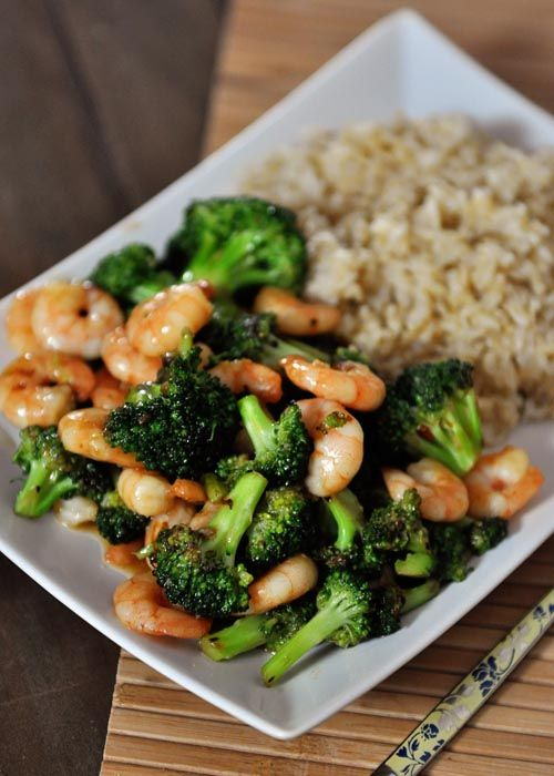 """Asian Broccoli Stir Fry aka Stir-Fried Broccoli with Brown Rice {Meat Optional}. """"..Even though you can see cute little shrimp pictured in this dish, I have to admit that often when I make it, broccoli is the star of the show, because a.) I love a good meatless meal and b.) stir-fried broccoli is amazing. Like, addicting amazing. And actually, the broccoli is the star of the show even when I throw in shrimp or chicken."""" from Mel's Kitchen"""