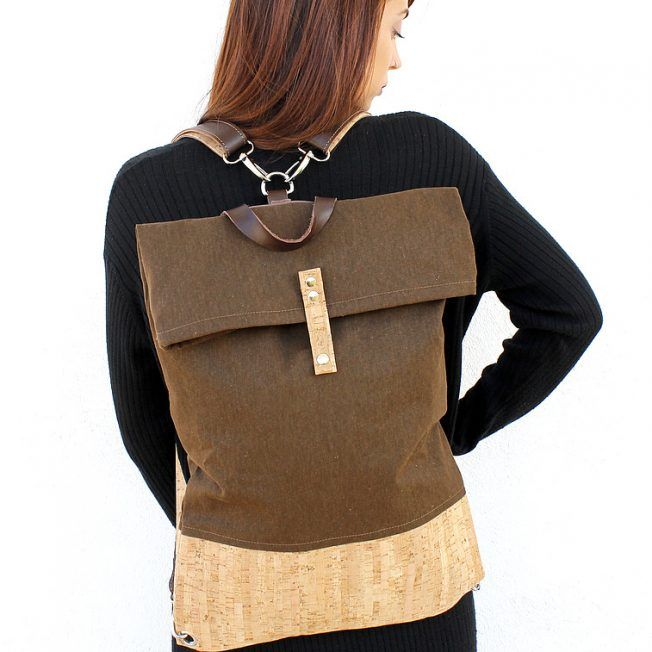 Flat unisex backpack featuring brown canvas and cork