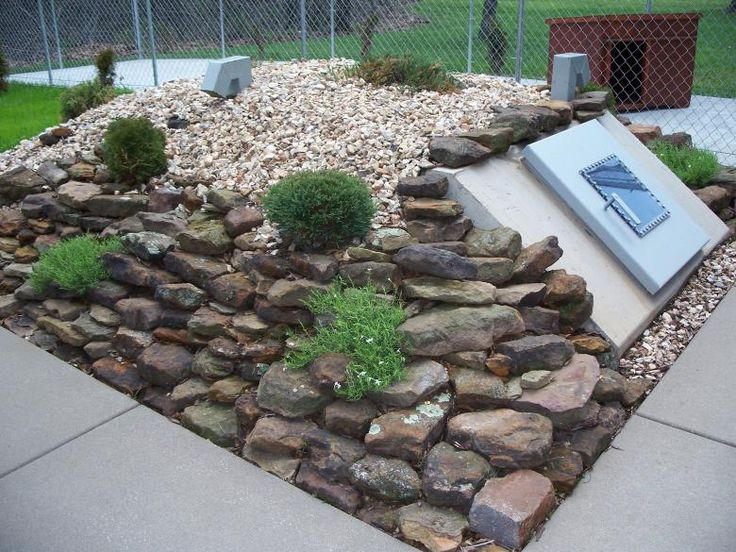 Landscaping on and around the Storm Shelter. This would work for a root cellar entrance, too.