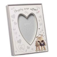 "£9.99 - Boofle Wedding Picture Frame A lovely picture frame designed for that special someone on their big day! It has the words ""Happily ever after"" on the top and a picture of a bride and groom boofle on the bottom. It has a heart shaped boarder for the photo which measures 5"" in height and 3.5"" in width. The entire frame is approximately 8.5"" x 6.5""."