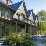 Actor   Bruce Willis  paid $9 million for this beautiful shingle-style home in Bedford, N.Y., just one hour north of New York City. The 8,400-square-foot mansion has five   bedrooms , six   bathrooms  and a 1,500-bottle climate-controlled wine cellar. The house boasts high ceilings and large windows, with terrific   views  of the Croton Reservoir. The impressive 14-acre grounds include a tennis court, guest   cottages  and a 50-foot swimming pool with a heated cabana.     | HGTV FrontDoor