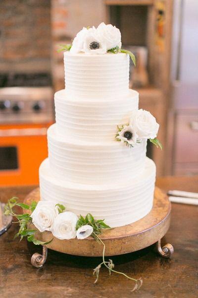 Classic wedding idea - four-tier, buttercream frosted wedding cake with fresh flowers {Arte De Vie}