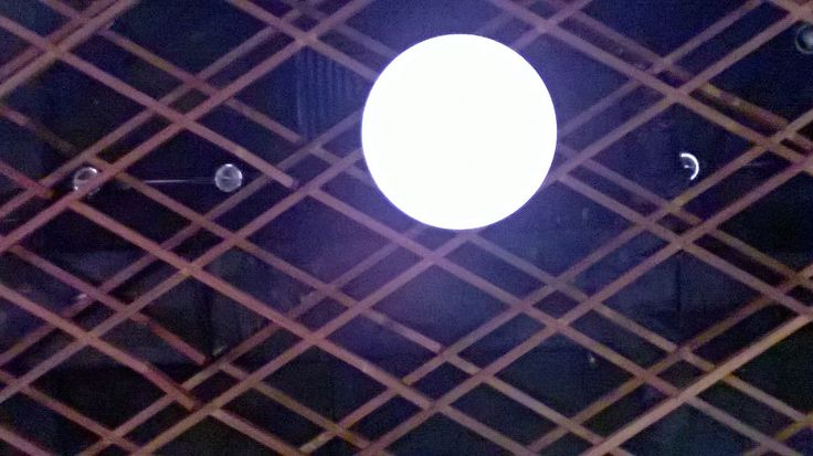 Wooden cage ceiling and lighting at Waha Kitchen Kosenda Hotel in Jakarta.