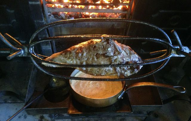 Food History Jottings: Fired Puddings from Enlightenment Edinburgh;A leg of mutton roasts in an eighteenth century cradle spit over Mrs Maciver's potato pudding. We made this one last weekend on my roasting course. One side of this joint was larded eighteenth century style with anchovies, the other in the earlier Baroque manner with strips of Seville orange peel