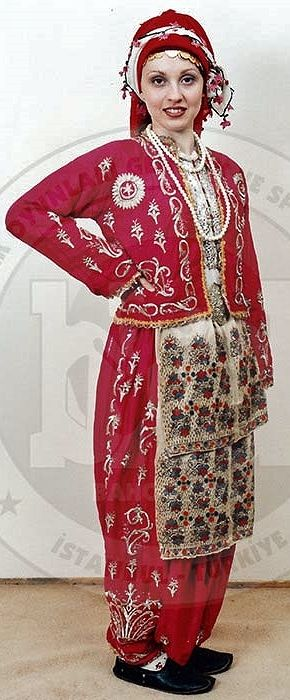 Traditional festive costume from the Silivri district (west of Istanbul, Trakya/Thrace).  Turkish, c. 1925.  The velvet 'şalvar' (baggy trousers) & 'cepken' (long-sleeved vest) are adorned with 'goldwork' embroidery in 'Maraş işi'-technique.  The circular sunflower-like motif on the vest bears a star & crescent design (= Turkish flag) in its center.  (Costume Collection of the Bakırköy Halk Oyunları Derneği, Istanbul).
