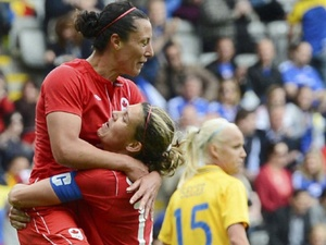 Melissa Tancredi and Christine Sinclair as Canada defeats Sweden-Olympics 2012