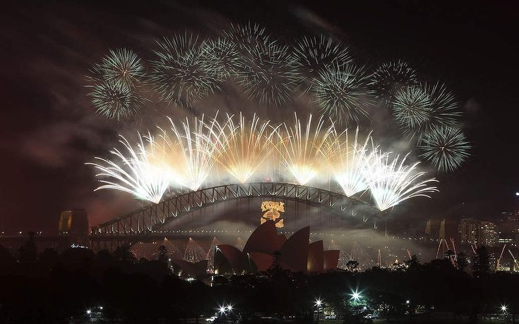 Fireworks explode in the sky above Sydney Harbour during the New Year celebrations in Sydney