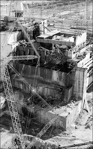 An aerial view of the fourth reactor of the Chernobyl nuclear power plant after its explosion is seen in this 1986 file photo. Scroll down for excerpts from Voices of Chernobyl.