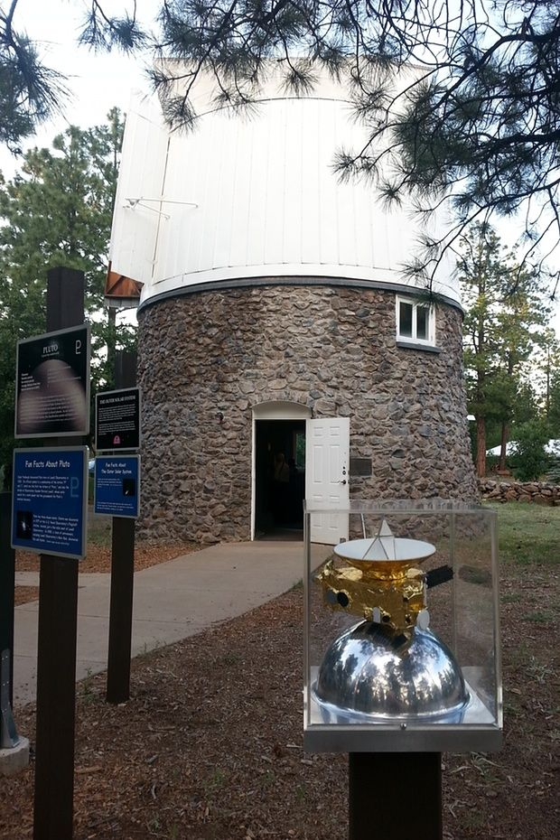 A model of the New Horizons spacecraft is on display outside the Pluto discovery telescope at Lowell Observatory in Flagstaff, Arizona