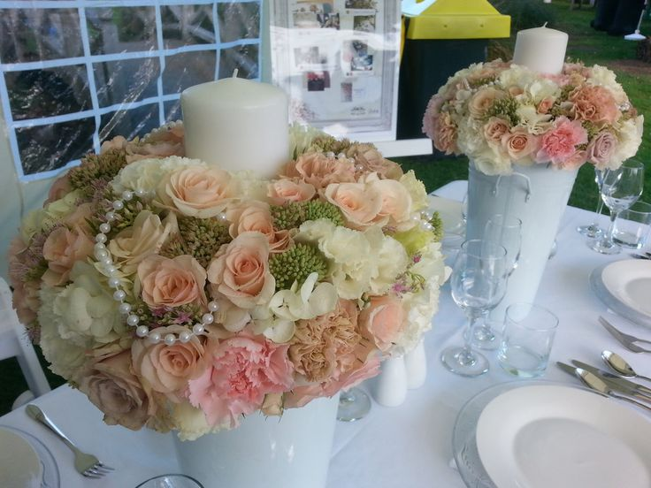 We designed this bouquet as a vintage centrepiece incorporating pearls and candles