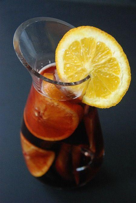 Laura's AppleJack Sangria...AppleJack Brandy, Real Sangria, lemon, apple, grapes, oranges