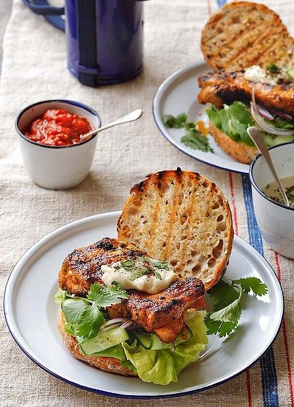 Bill Granger's grilled chicken thigh burger with tahini and chilli relish. Photo by Marina Oliphant. Recipe: http://www.smh.com.au/lifestyle/cuisine/poultry/recipe/grilled-chickenthigh-burgers-with-tahini-and-chilli-relish-20111021-1mbok.html?rand=1348024864010