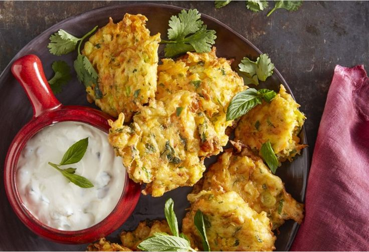Crisp-fried vegetable fritters served a tzatziki dipping sauce are fabulous finger food for winter entertaning.