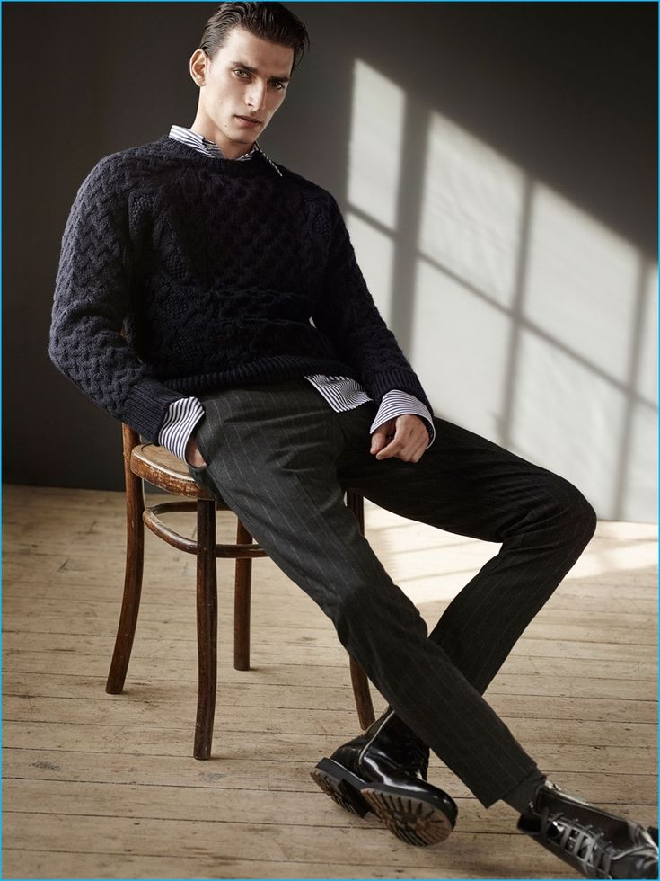 Thibaud Charon embraces a smart look from Zara Man, wearing a fisherman sweater with pinstripe trousers, and black boots.
