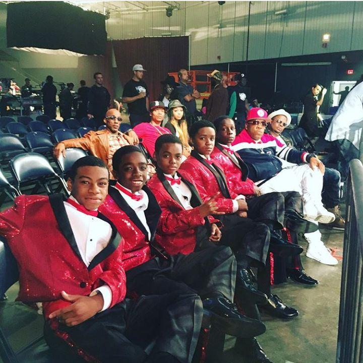 The Younger Version of New Edition in the Movie sitting and posing with real members of New Edition