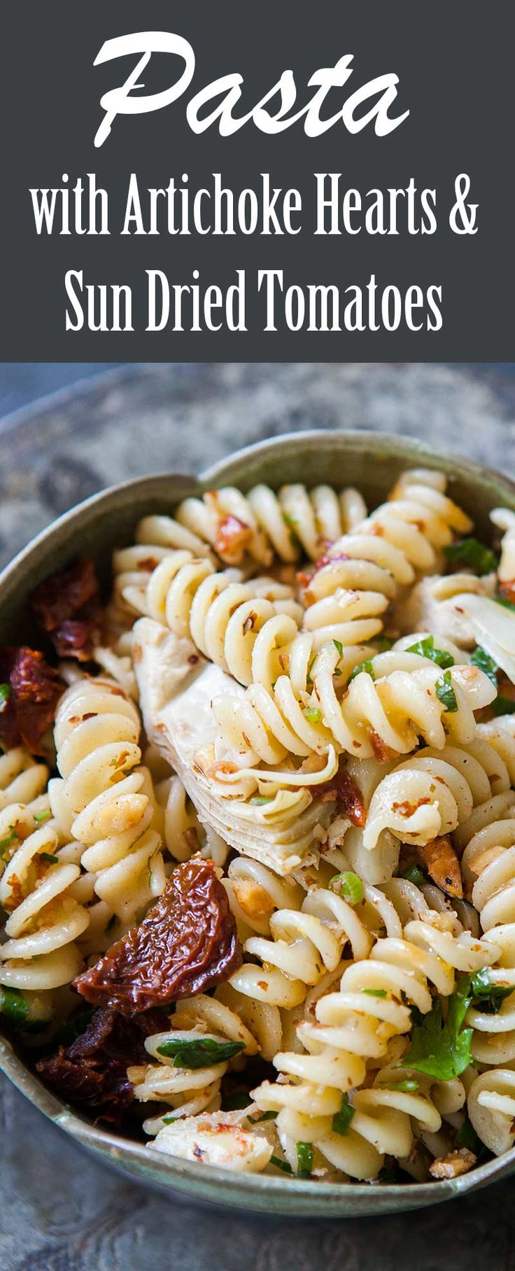 Fusilli pasta tossed with marinated artichoke hearts, sun-dried tomatoes, and toasted almonds. Easy VEGAN pasta dish, perfect for a potluck!