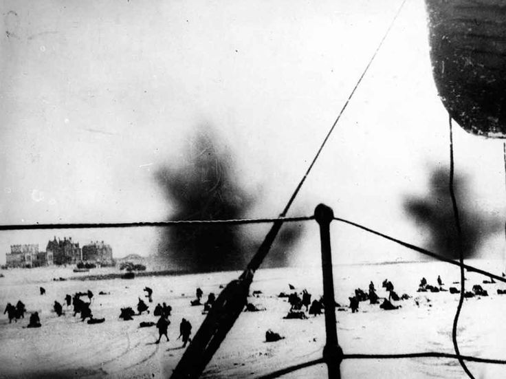 Troops under fire on the beaches of Dunkirk, as seen from a ship offshore. Dunkirk evacuation underway