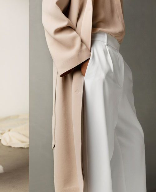 The Masculine Look: Layered neutral outfit with long wool coat.