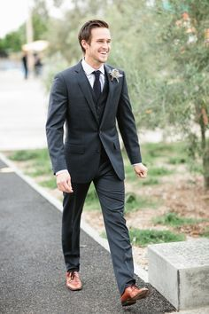 Wearing black suit with brown shoes