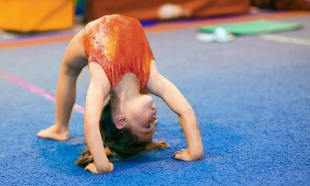 Kids 18 months to 5 years old practice coordination, floor work, and skill mastery during tumbling or gymnastics classes organized by age