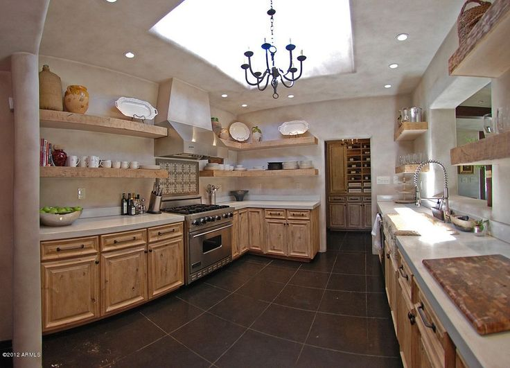 Mediterranean Kitchen with Custom Knotty Pine Cabinetry, Limestone, Skylight, Heritage 8 Light Chandelier, Limestone counters
