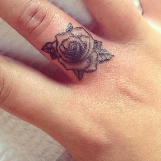 Awesome black-and-white rose flower tattoo on finger