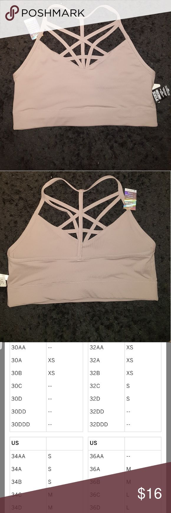 Lightly lined PINK ultimate sports bra Nude sports bra with strappy detailing on front and one strap going up the middle of the back (forms a t shape when it meets with shoulder straps!) Very comfy and supportive  - 4 way stretch  - wicking fabric  - breathable  -quick dry fabric PINK Victoria's Secret Intimates & Sleepwear Bras