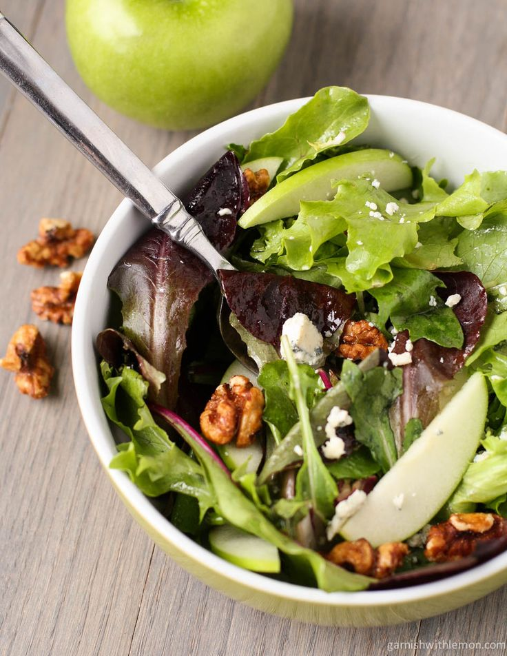 Mixed Green Salad with Blue Cheese Crumbles and Candied Walnuts | Garnish with Lemon