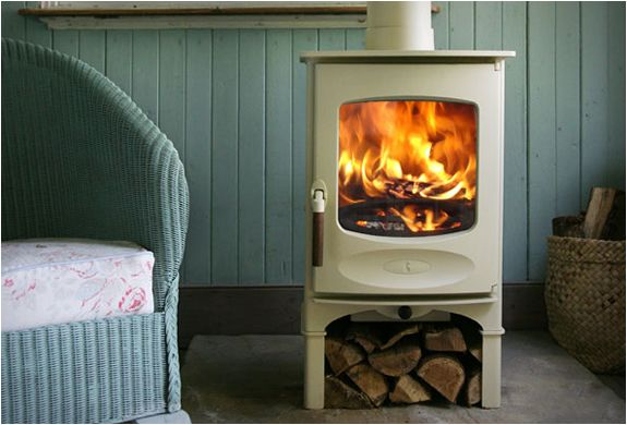 C-FOUR WOOD STOVE BY CHARNWOOD  the little C-four model features a single air control for exceptional clean burning and outstanding efficiency, it also allows for wood to be burnt in smoke control areas. Available in 8 colors.