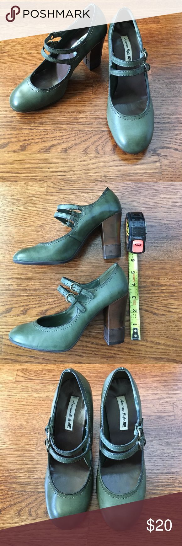 """American Eagle olive green Mary Jane pumps American Eagle olive green Mary Jane pumps. All man-made materials. Super cute double buckles and brown and tan color block 3.75"""" heels. Only worn a few times, minor scuffs as shown in pics. US 7.5 American Eagle by Payless Shoes Heels"""