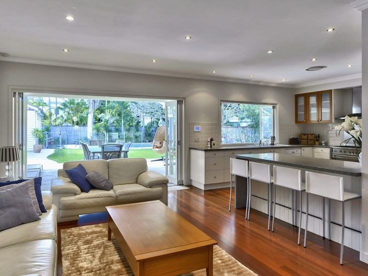 Queenslander open plan kitchen on ground floor with garden/pool views