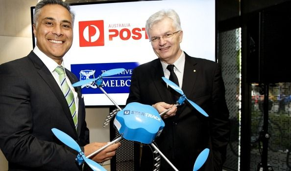 Australia Post CEO Ahmed Fahour, left, and University of Melbourne vice-chancellor Glyn Davis with drone technology that could be used to deliver parcels from door-to-door.