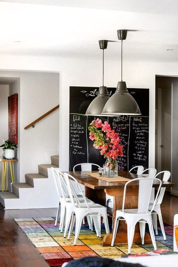 Dining area with white tolix chairs designed by Collected Interiors